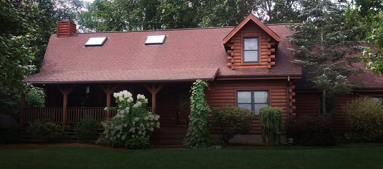 roof cleaning on log cabin home in northeast indiana